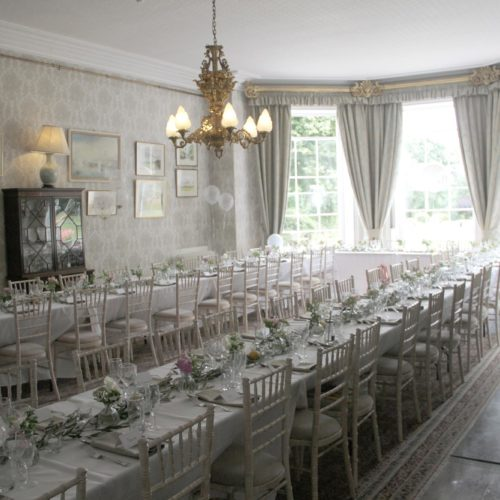 Banqueting style wedding breakfast table in the Dining Room at Homme House