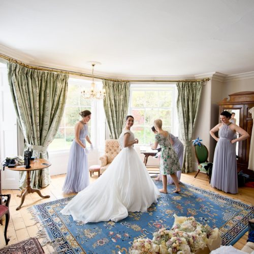 Bride and bridesmaids getting ready in the Bridal Suite at Homme House