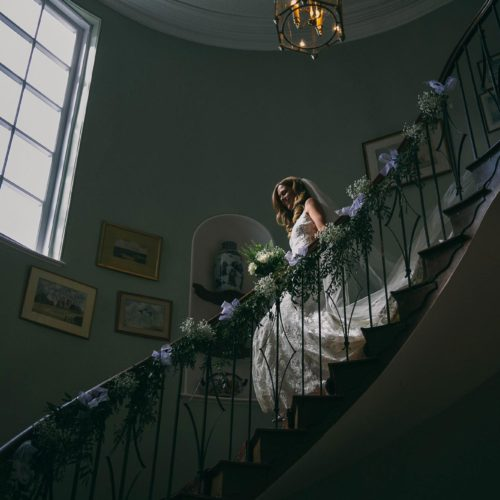 Bride on the flying staircase at Homme House