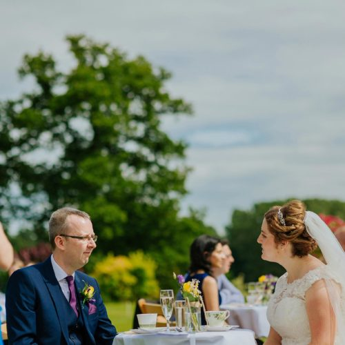 Bride and Groom enjoying afternoon tea on the main lawn at Homme House