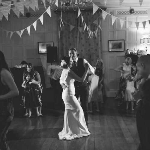 Bride and groom dancing in the Panelled Room at Homme House