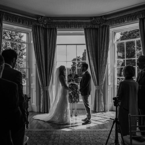 Bride and groom facing during humanist wedding ceremony at Homme House