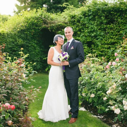 Bride and groom in the rose garden at Homme House