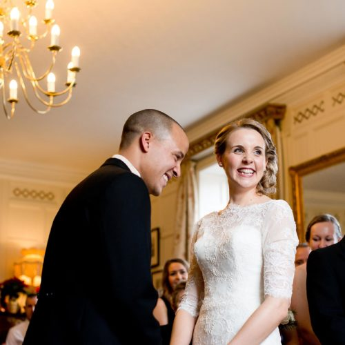 Bride and groom during wedding ceremony in the Panelled Room at Homme House