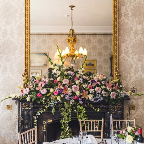 Floral arrangement on the Dining Room mantelpiece at Homme House