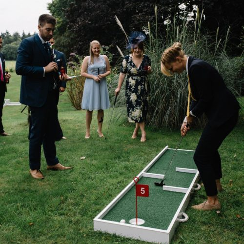 Guests playing crazy golf at a Homme House wedding