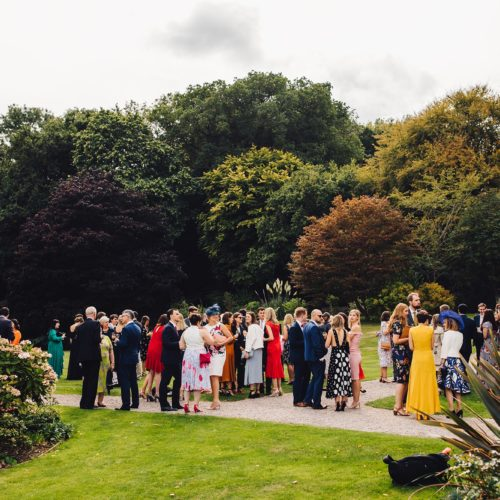 Wedding guests on main lawn at Homme House