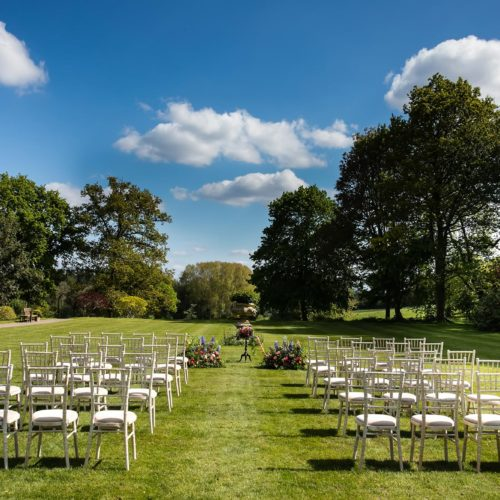 Wedding ceremony furniture on lawn at Homme House