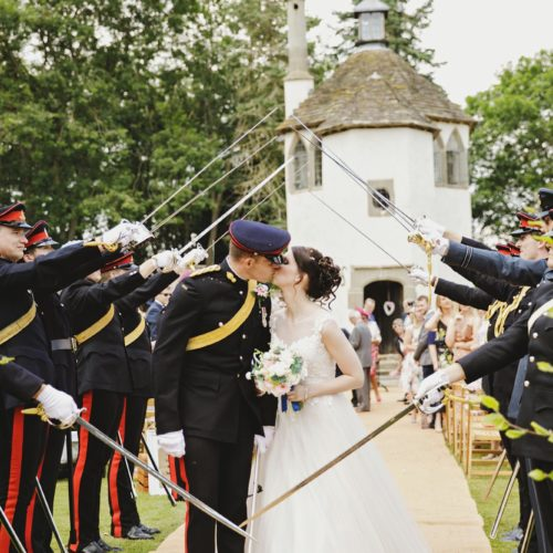 Military guard of honour at end of outdoor wedding ceremony at Homme House