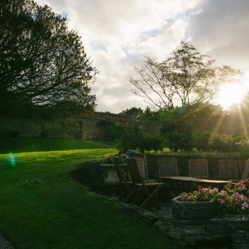 Patio in the main garden at Homme House in evening light