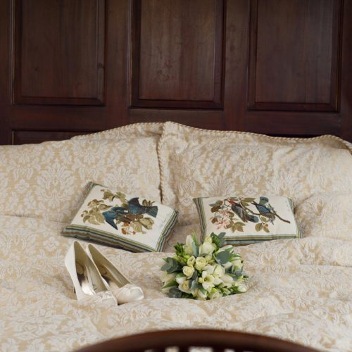 Shoes and bouquet on Bridal Suite bed at Homme House