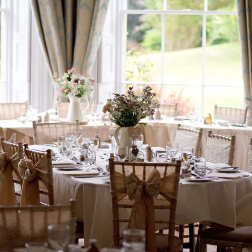 Wedding breakfast tables and chairs decorated in the Dining Room at Homme House