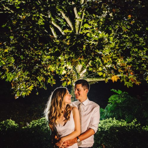 Wedding couple photograph in front of tree in evening light