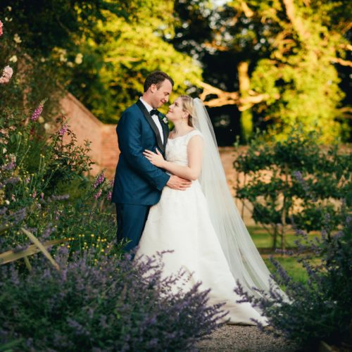 Wedding couple photograph in front of the borders of the walled garden at Homme House