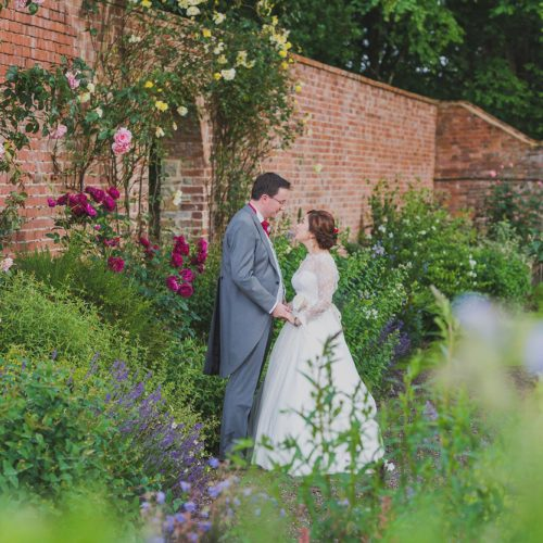 Wedding couple in walled garden at Homme House