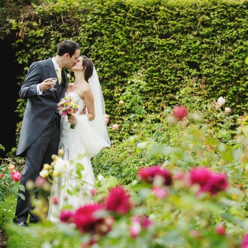Wedding couple portrait in the rose garden at Homme House