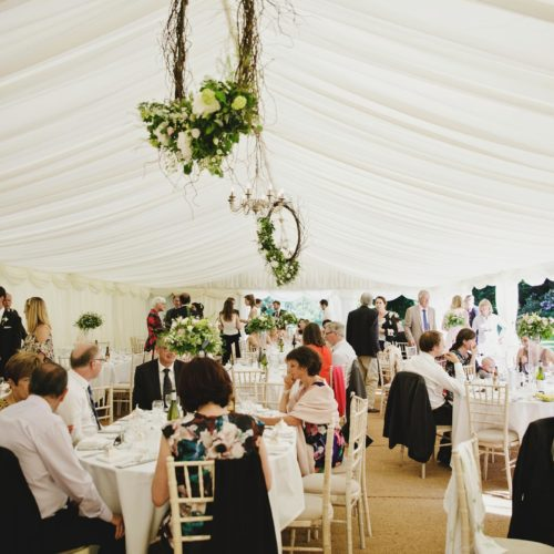 Wedding guests in marquee at Homme House