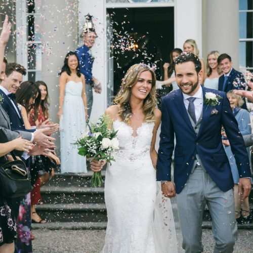 Wedding couple showered with confetti following wedding ceremony at Homme House