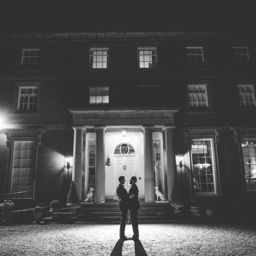 Wedding couple portrait outside Homme House at night