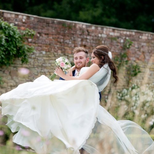 Wedding couple portrait in the walled garden at Homme House