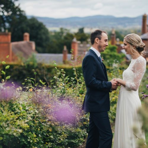 Wedding couple portrait in walled garden at Homme House