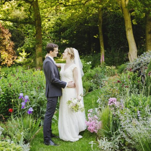 Wedding couple portrait in water garden at Homme House