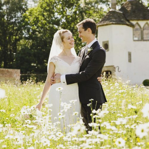 Wedding couple portrait in walled garden wildflower meadow at Homme House