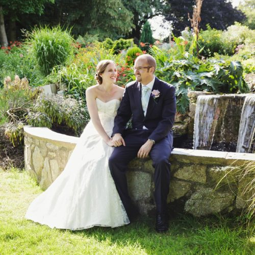 Wedding couple beside water feature