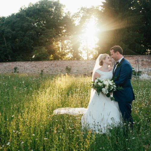 Wedding couple portrait in Homme House wild flower meadow in the evening light