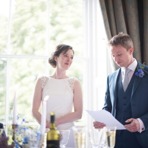 Bride and groom giving a wedding speech together at Homme House