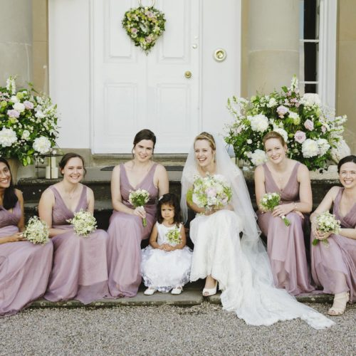 Bride and bridesmaids on the front steps at Homme House