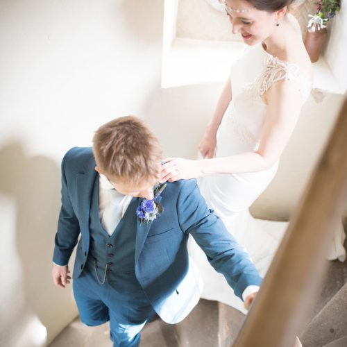 A bride and groom descend the Summerhouse spiral staircase at Homme House