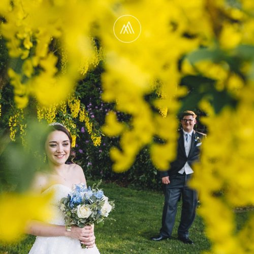 Bride and groom under laburnum at Homme House