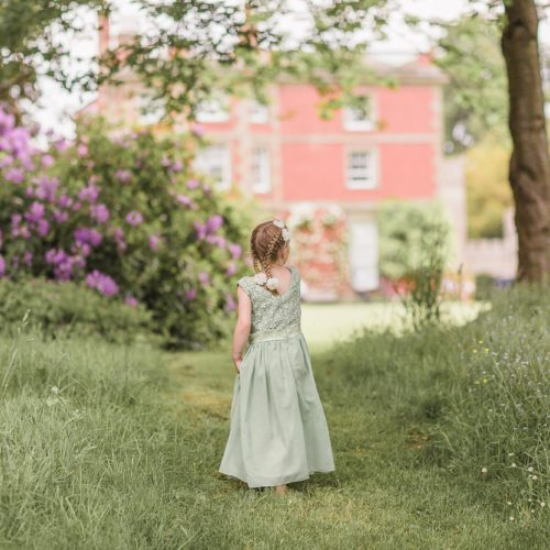 A flower girl in the main garden at Homme House