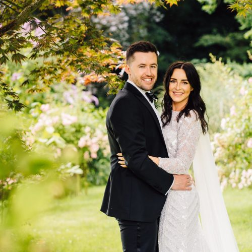 A wedding couple portrait under the acer on the main lawn at Homme House