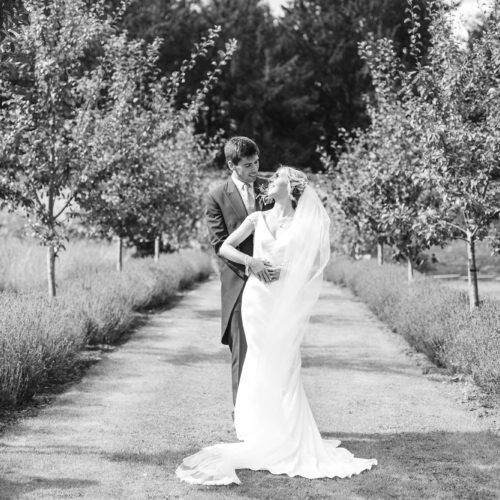 Bride and groom portrait on the lavender walk at Homme House