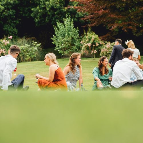 Guests sitting on the main lawn at Homme House