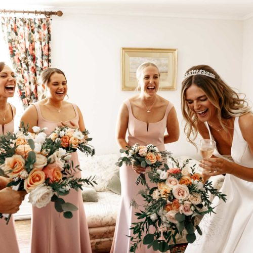 Bride and Bridesmaids Laughing in the Bridal Drawing Room at Homme House