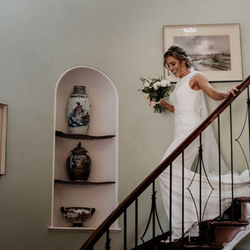 A bride descends the stairs at Homme House