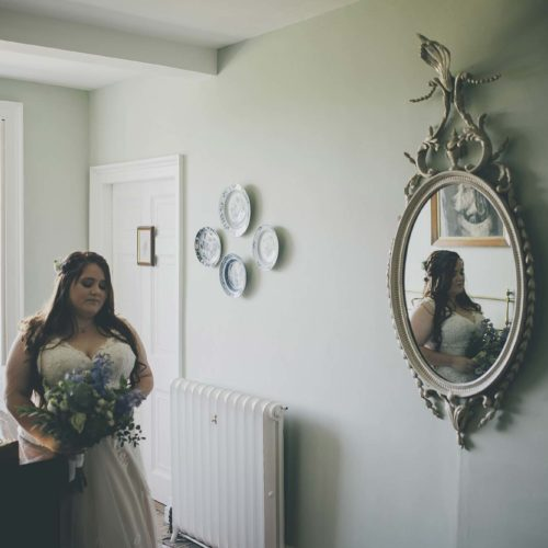 A bride reflected in a mirror
