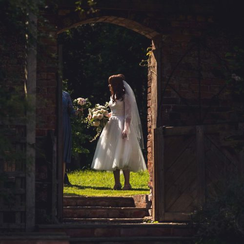 Bride seen through gateway