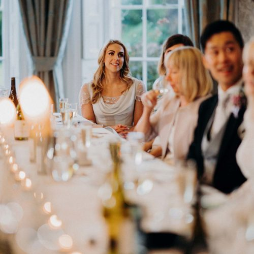 Guests at a banqueting table in the Dining Room at Homme House