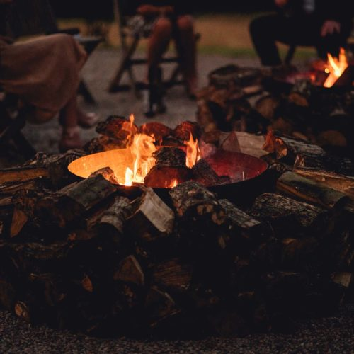 Firebowls on the gravel outside Homme House
