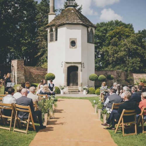 An intimate wedding ceremony outside a Summerhouse