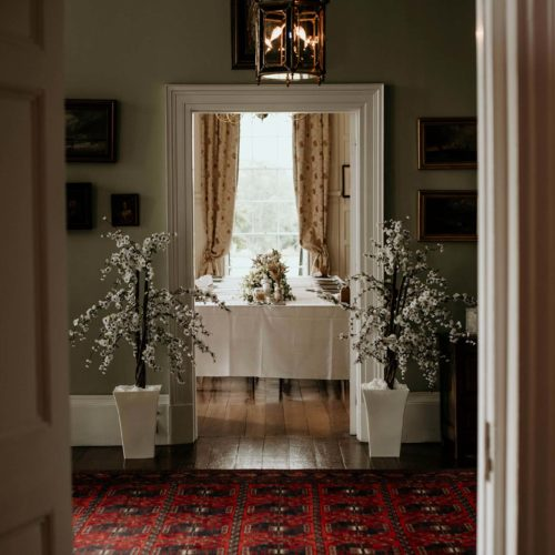 A wedding breakfast dining table in the Panelled Room at Homme House