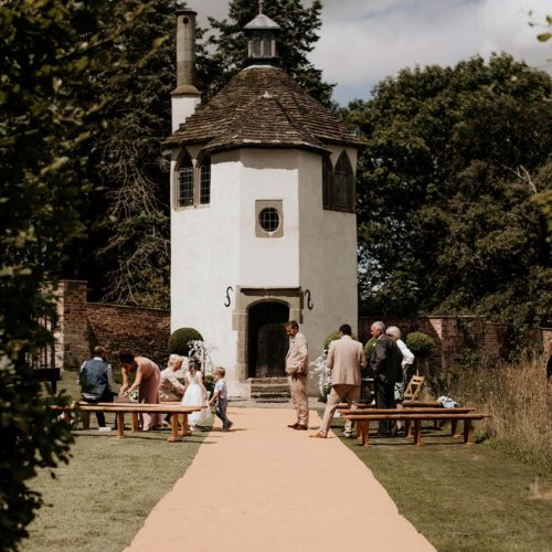 A Summerhouse wedding ceremony with bench seating