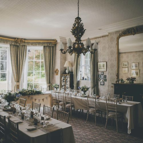 A u shaped dining table for a wedding breakfast