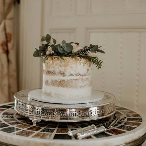 A wedding cake in the Panelled Room at Homme House