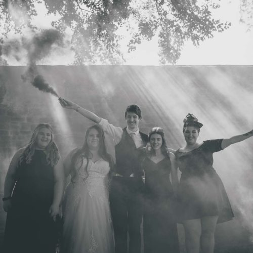 A wedding group with smoke bombs